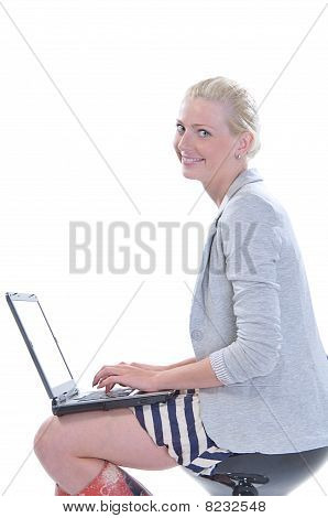 Woman With A Laptop Isolated On White