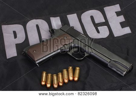Colt Government M1911 Handgun With Ammo On Police Uniform