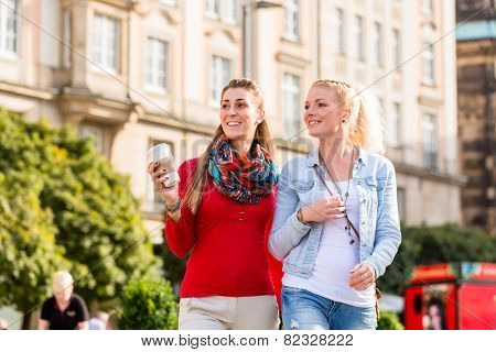 Friends, tourist women, taking walk in the city of Dresden