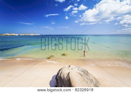 Woman on the beach in Portugal celebrate a wonderful day