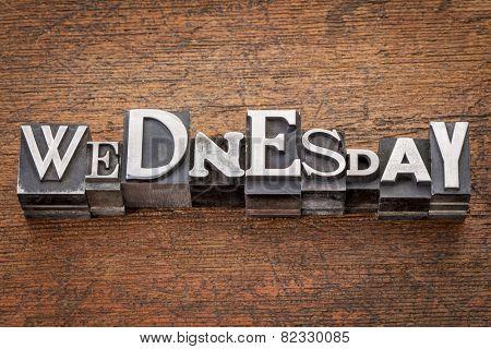 Wednesday word in mixed vintage metal type printing blocks over grunge wood