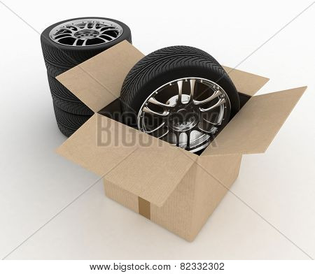 Open Cardboard Box with Tires on white background