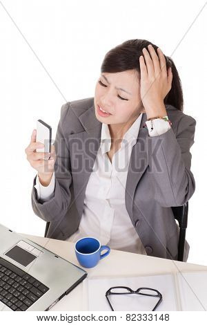 Worried business woman using cellphone on white background.