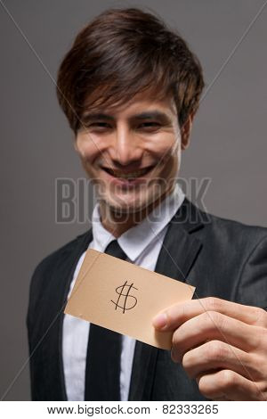 Asian business man holding card writing sign, closeup portrait focus on card.