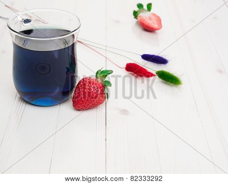 Blue Thai tea with strawberries and dry painted flowers