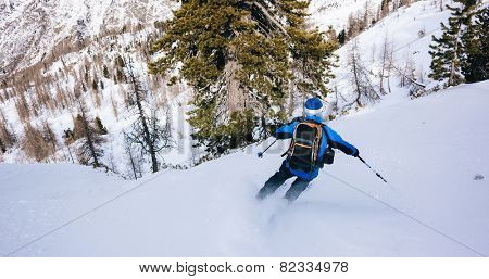 Winter sport: man skiing in powder snow. Val D'Aosta, italian Alps, Europe.