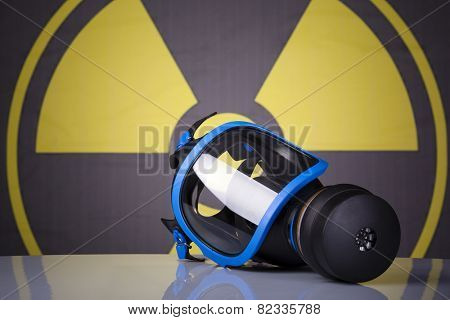 Gas mask on toxic symbol background