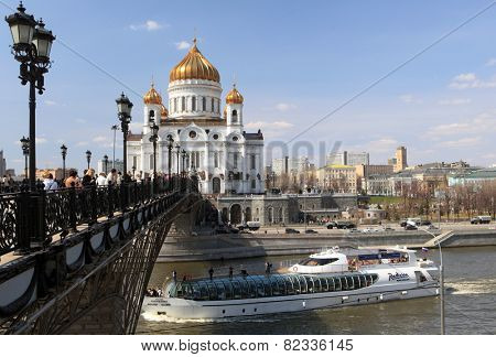 MOSCOW, RUSSIA - APRIL 24, 2011: Yacht of Flotilla Radisson Royal on the river against the Cathedral of the Christ the Savior. Working all year round, the Flotilla carry 500,000 passengers per year