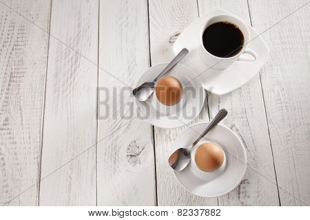 Top view of the black coffee and hard boil egg