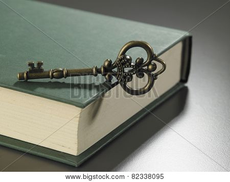 retro golden key on thick hard cover book