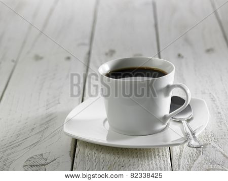 cup of black coffee on the white table