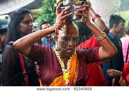 KUALA LUMPUR, MALAYSIA - FEBRUARY 3, 2015: Hindu devotees perform prayers at the Sri Mahamarriamman temple in Batu Caves. Hundreds of thousands of Hindu devotees come here for the Thaipusam prayers.