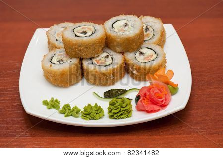 Roasted roll with cream cheese, cucumber and salmon fish