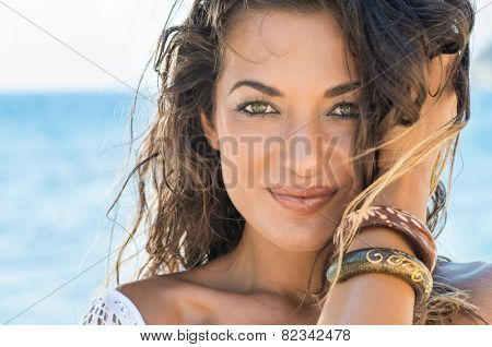Close Up Of Carefree Girl Looking At Camera At Tropical Beach