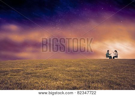 Sitting couple having an argument against aurora night sky in purple