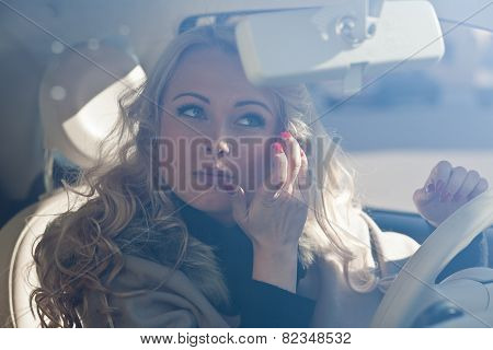 Beautiful Girl Checking Her Makeup In Her Car