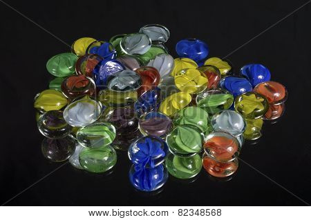 Colorful Cat-eye Marbles On Black Glass Mirror
