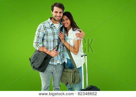 Attractive young couple going on their holidays against green vignette