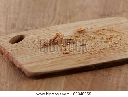 Bread crumbs on cutting board on wooden background