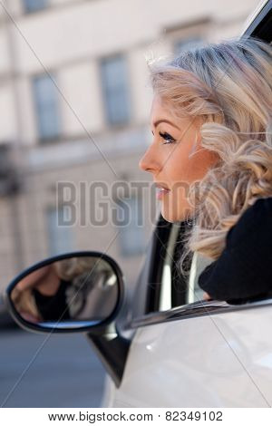 Tourist Watches Something From Her Car