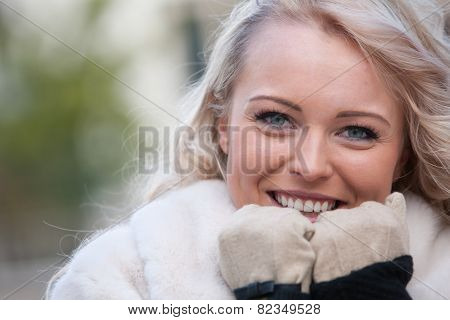 Beautiful Woman Smiling With Gloves