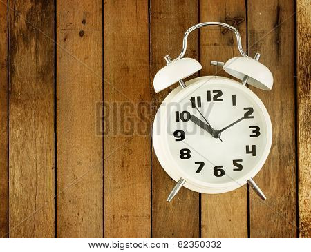 Classic Alarm Clock On Wooden