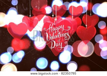 Happy valentines day against twinkling red and blue lights