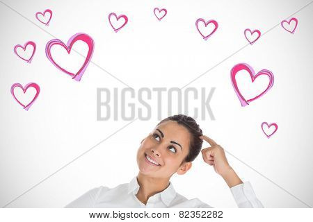 Smiling thoughtful businesswoman against white background with vignette