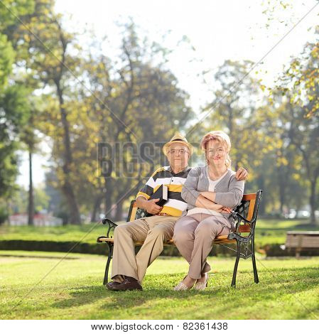 Relaxed mature couple enjoying a sunny day in park shot with atilt and a shift lens