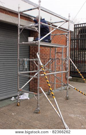 Working on scaffold tower
