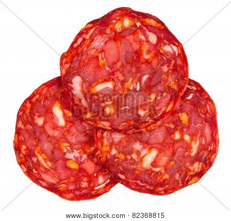 Cut Spanish sausage or salami chorizo. Isolated on white