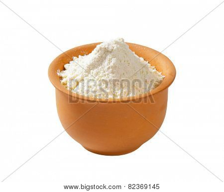 Finely ground flour in terracotta bowl