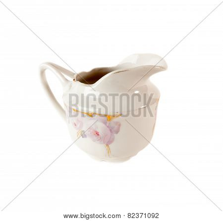 Porcelain Gravy boat with floral ornament isolated over white background