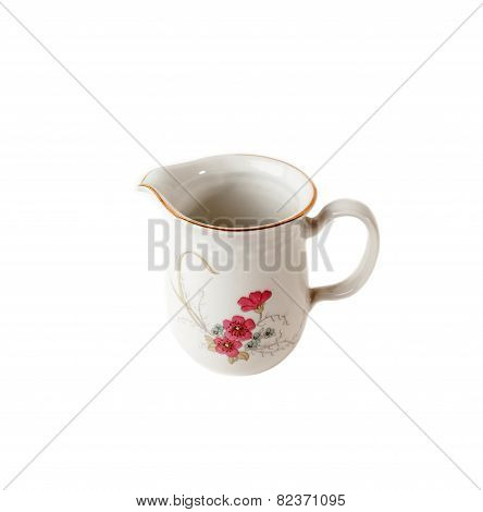 Porcelain Gravy boat with floral patterns isolated over white background