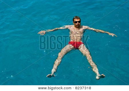 Man Swimming In Glasses For Diving