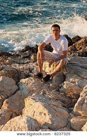 Man Sitting Near The Sea