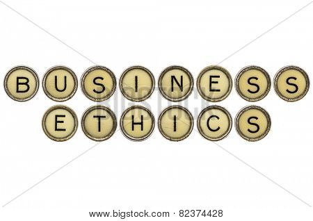 business ethics text  in old round typewriter keys isolated on white
