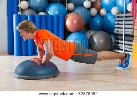 Bosu diamond push up blond man exercise at gym workout