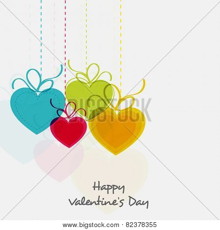 Colorful hanging heart shape balloons for Happy Valentine's Day celebration on white background.
