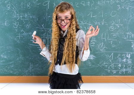 Clever nerd pupil blond girl in green board student happy schoolgirl
