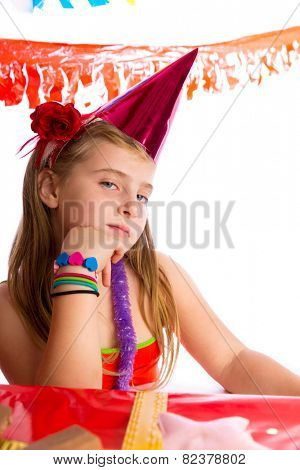 Bored gesture blond kid girl in party with birthday hat portrait on white