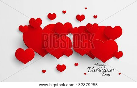 Happy Valentine's Day celebration love greeting card decorated by glossy red hearts.
