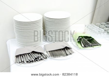Catering - Stacks Of Plates And Cutlery