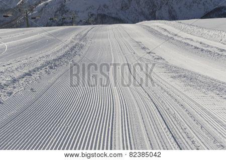 Fresh Snow Groomer Tracks On A Ski Piste