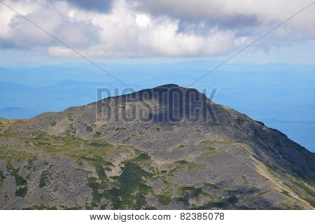Storn Clouds High Over The Mountain Top