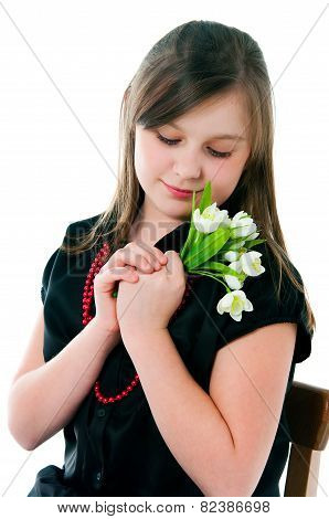 The Image Of The Girl With A Bunch Of Flowers