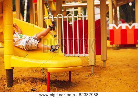 Boys Legs On Yellow Slide