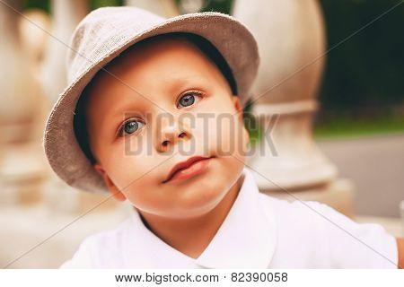 Little Serious Boy In Hat