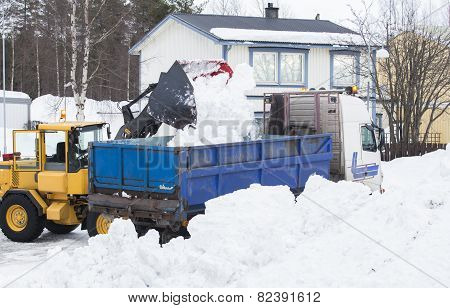 Wheel loader unloading snow