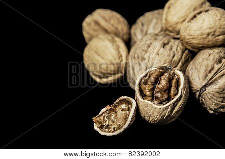 Walnuts on a black background in horizontal format